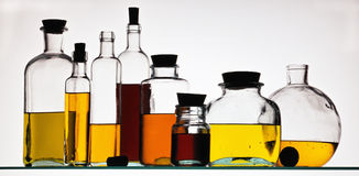 Oil in bottles Stock Photos