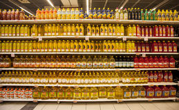 Oil bottles on the shelves of a store Stock Photography