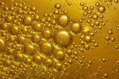 Oil bubbles. Golden bubbles made from vegetable oil and water Royalty Free Stock Photo