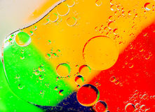 Oil bubbles abtract. Oil drops on a water surface. Abtract background Stock Image