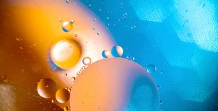 Oil with bubbles on a colorful background. Abstract background. Soft selective focus. Texture water drop reflection liquid light blue beauty macro surface stock image