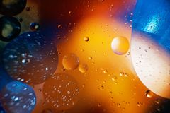 Oil with bubbles on a colorful background. Abstract background. Soft selective focus. Oil with bubbles on a colorful background. Abstract blured background. Soft stock images