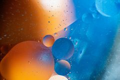 oil with bubbles on a colorful background. Abstract background. Soft selective focus stock photography