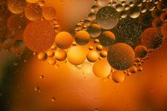 Oil with bubbles on a colorful background. Abstract background. Soft selective focus. Oil with bubbles on a colorful background. Abstract blured background. Soft stock image
