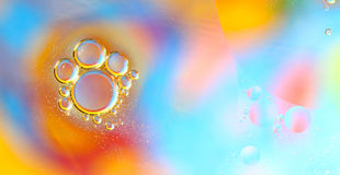 Oil bubbles on water abstract Stock Photos