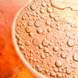 Oil bubbles on a water surface Stock Photography