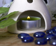 Oil burner with a candle Royalty Free Stock Images