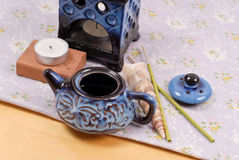 Oil Burner with Trinkets. Kettle Shaped Oil Burner with Trinkets royalty free stock photo