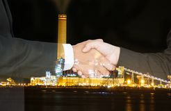 Oil business success. Business people shake hand success a contract with the crisis, oil price fluctuate royalty free stock image