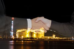 Oil business success. Business people shake hand success a contract with the crisis, oil price fluctuate stock photo
