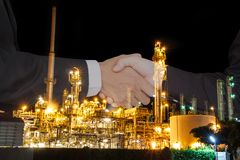 Oil business success. Business people shake hand success a contract with the crisis, oil price fluctuate stock photography