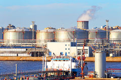 Oil business terminal. The tanker in port. Production and trade in oil products. Stock Photos