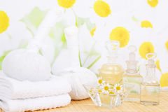 Oil and camomile with towels - spa decoration Stock Photos
