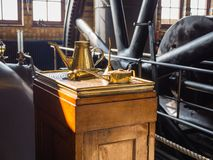 Oil can used in a machine room of pumping station Royalty Free Stock Images