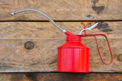 Oil can on wooden background, Lube oil can and used in industry or hard works Stock Image