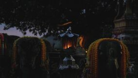 A oil candle in Loy Krathong celebration in Thailand, isolated in dark background, slow motion
