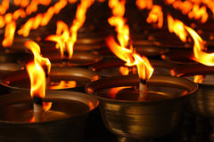 Oil candles in a Chinese temple.  Royalty Free Stock Photo