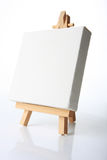 Oil canvas. Empty artistst canvas on an easel, shot on white, put your own image on it Stock Photo