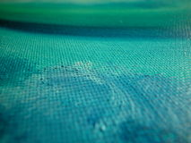 Oil on canvas texture detail. Macro of blue and green waves of oil on canvas colours Stock Photos