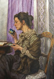Oil on canvas of a woman drinking while reading his book Royalty Free Stock Photos