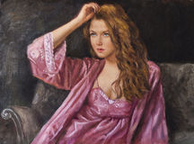 Oil on canvas of a young woman with her hand through her hair Stock Image