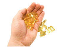 Oil capsules Stock Photos