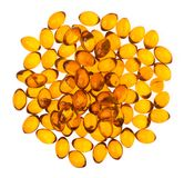 Fish oil capsules on white background. Oil capsules arranged in a circular shape contains unsaturated fatty acids royalty free stock images