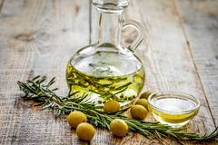 Oil in carafe with spices and olive on wooden background mock-up. Extra oil in carafe with spices and fresh olive on wooden desk background mock-up royalty free stock photos