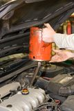 Oil Change. Mechanic refilling the pan during an automobile's oil change Stock Image