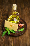 Oil, cheese , tomato and basil Stock Photography