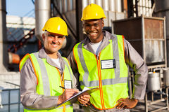 Oil chemical co-workers. Oil and chemical co-workers in refinery plant stock photo