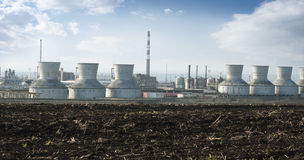 Oil and chemical refinery. For production of petroleum products. Land on foreground Royalty Free Stock Image