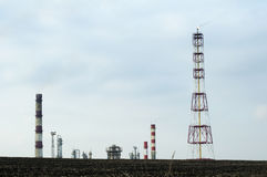 Oil and chemical refinery. For production of petroleum products. Land on foreground. Flame Stock Image