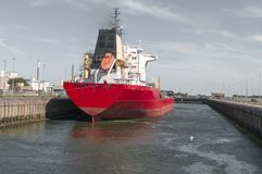 Oil Chemical Tanker Vessel in the canal. Oil Chemical Tanker Vessel is moored in a large lock Stock Photo
