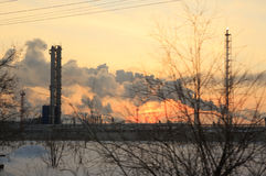 Oil Chemistry Refinery at sunset sky background in winter. Royalty Free Stock Photos