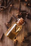 Oil of cloves in the bottle close-up vertical top view Stock Photo
