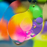Oil color lighting. Oil melt in water and color transparent Royalty Free Stock Photos