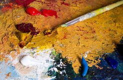 Oil colors and brush on a palette Stock Photos