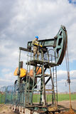 Oil company worker on the well Stock Images
