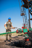 Oil company worker on the well Stock Photo