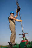 Oil company worker on the well Royalty Free Stock Images