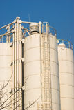 Oil containers. Low-angle shot of ladder and tanks refinery Stock Image