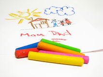 Oil crayons and children's drawing. On background Royalty Free Stock Images