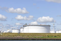 Oil depot with storage tanks and wind turbine Stock Photography