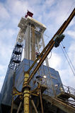 Oil derrick. View on side auxiliary crane stock images