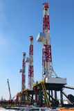 Oil derrick. On background of sky stock photography