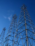 OIl Derrick. Three large oil derricks against clear a blue sky Stock Photography