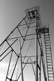 The oil derrick. The thrown old rusty oil derrick Stock Images