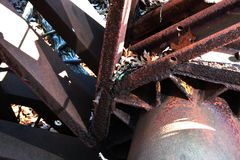 Oil Derrick detail. Detail of part of a forgotten and abandoned oil Derrick in the forest.  Part of one of the wheels that helped pump the oil out of the ground Stock Photo