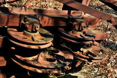 Oil Derrick detail. Pulleys at the top of a rusting collapsed oil Derrick in the forest stock images